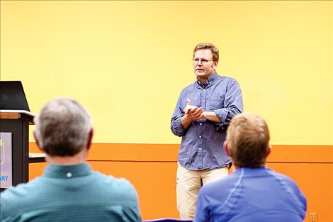 Tom Bansak, an aquatic ecologist and assistant director of the Flathead Lake Biological Station, fields questions from the Mission Mountain Audubon Society during an educational and informational program held Thursday evening at the Polson library meeting room.