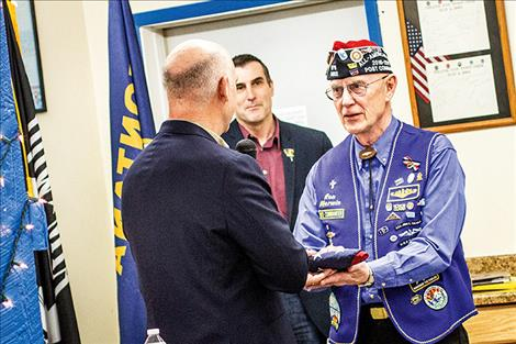 "U.S. Rep. Greg Gianforte presents an American flag to Ronald ""Ron"" Merwin that was flown above the United States Capitol in his honor."