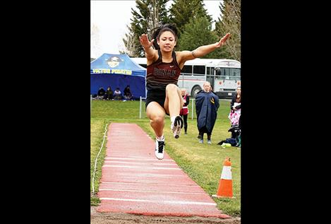 Mission Lady Bulldog Tiana Ulutoa leaps through the air at a track and field event in April.
