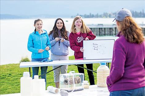 Joslin Howell, Abbey Howlett and Krystanna Larson put their aquatic invasive species knowledge to the test.