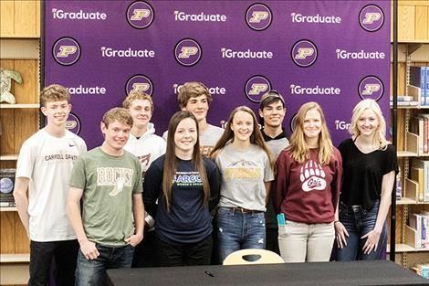 Nine Polson High School athletes from the Class of 2019 gathered Wednesday evening in the high school library to sign their national collegiate letter of intent continuing their athletic and academic careers. Pictured from left (front row): Quin Stewart, Ashlee Howell, Molly Sitter, Bea Frissell, Alexia Biederman; (back row) Robin Erickson, Mack Moderie, Matt Hobbs, Jonah DuCharme. (Andrey Bauer not pictured.)