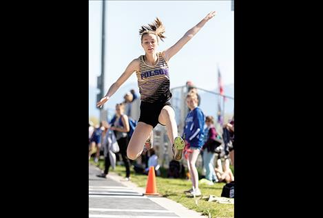 Polson Lady Pirate Mikaela Ducharme flies through the air in the triple jump.