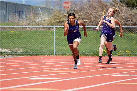 Charlo Lady Vikings Tyrah Hammond and Kaitlin Cox race in the 4X100 rela