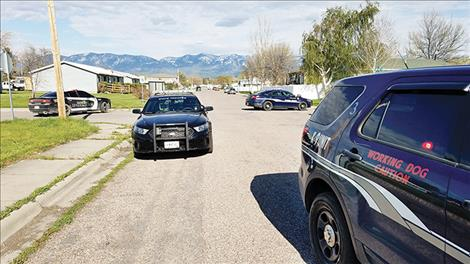 Law enforcement worked together in Polson to make arrests at 1002 5th St. in Polson. Dangerous drugs and devices for packaging and ingesting  them were found during the search.