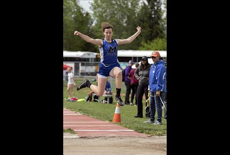Mission Lady Bulldog Afton Brander competes in the long jump