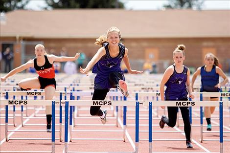 Charlo Lady Viking Carlee Fryberger races to a first place 100-meter hurdle finish.