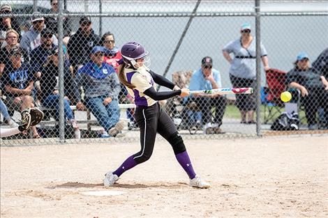 Polson Lady Pirate Lexi Orien makes contact for a base hit.