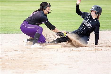 Polson Lady Pirate Savanna Carpentier makes the play at second; however, the umpire thought otherwise.