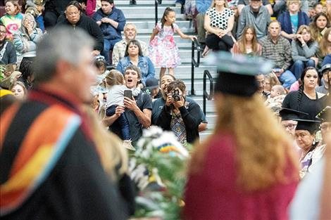 Family and friends of graduates grab some picture-perfect moments.
