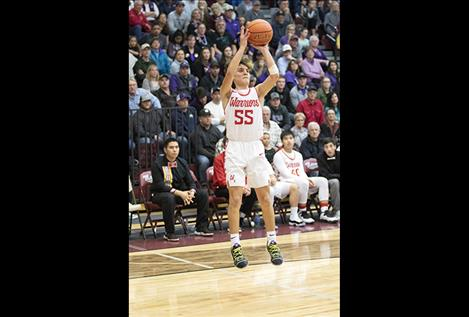 Arlee Warrior Greg Whitesell shots a jumper during a Class C divisional post season game.