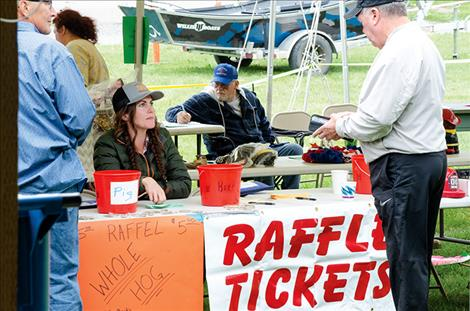 Firefighter Amanda Rice sells raffle tickets during the St. Ignatius Volunteer Fire  Department picnic.