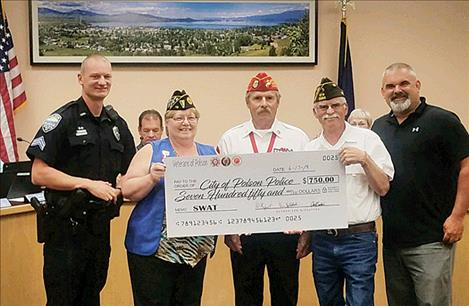 The favor is returned to the police department as veterans present money for training.
