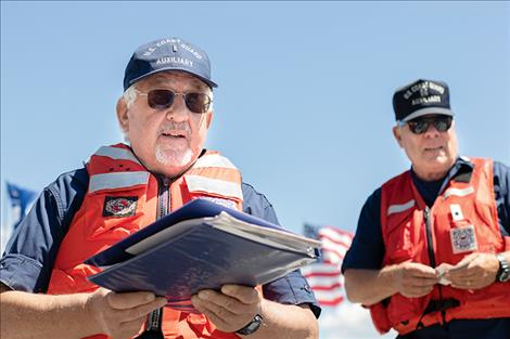 U.S. Coast Guard Auxiliary volunteer Chris Roberts and Flotilla Commander Kyle Boyce perform water vessel safety checks.