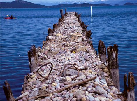 With the planks removed from the old city docks, only rocks and pilings remain, waiting for a new cover.