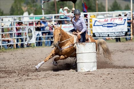Charlo barrel racer Hailey Weible races to a 15.03 second place finish.