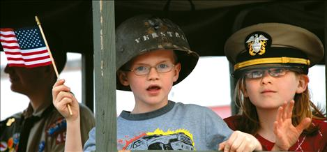 Colton Pieper and Kaitlynn Lamphere ride in the Freedom Truck, a WWII-era six-top troop carrier, in Polson's Memorial Day Parade.