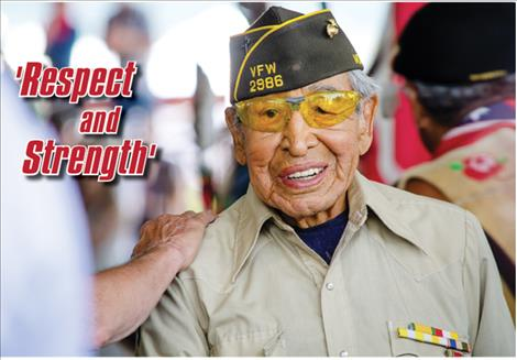 Tribal elder and World War II veteran Francis Stanger is shown respect along with other veterans during the opening ceremony of the 121st Arlee Esqapqeyni on Thursday.