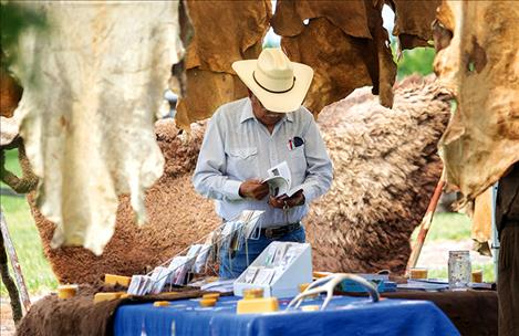 Hides are displayed during the Ninepipes Museum of Early Montana Fourth Annual Cultural Arts Fair on Saturday, where crafts and food items were also for sale.