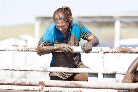 Contestants get increasingly muddy during climbing obstacles.