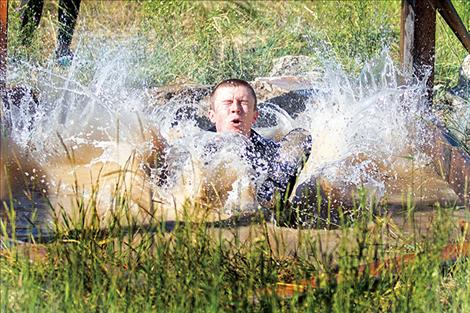 A competitor splashes down during the sixth annual Polson Mud Run at the Polson Fairgrounds on Saturday morning.