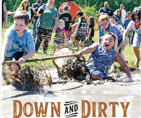 Children get pulled into a muddy pit during the tug-of-war competition at the Good Old Days park on Saturday.