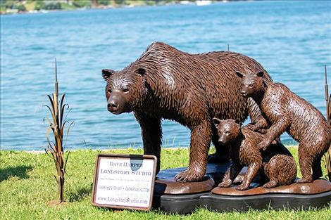 A wildlife sculpture is featured in an outdoor setting.