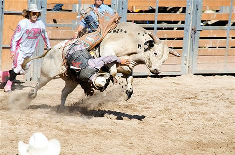 Bullriders compete in the rodeo on Sunday.