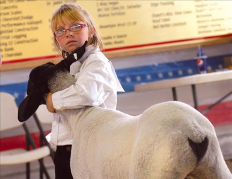 Gabby Smith hangs onto her foundation lamb during the sheep show.