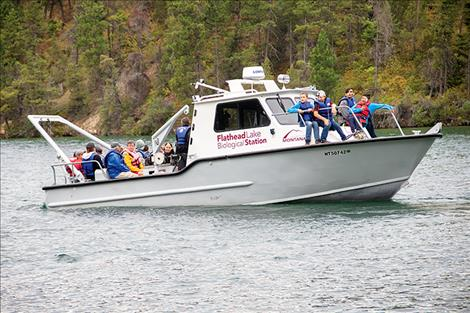 The Flathead Lake Biological Station staff give children a ride on their boat during the open house.