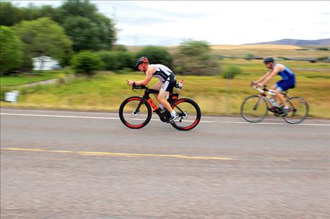 Cyclists compete in one of three triathlon events.