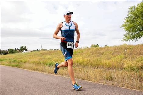 Joel Bischoff races towards the finish line as the 2019 Polson Triathlon overall champion.