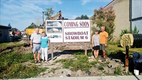 Howard and Ayron Pickerell and Becky and Gary Dupuis stand in front of the site of their family-owned theater project.