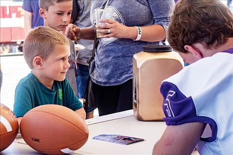 The Polson Pirates football team  provided  admiring  fans with  autographs.