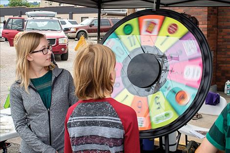 A  child  takes a spin on the free prize wheel.