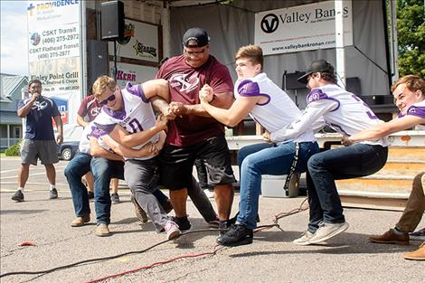 Polson Pirate Football team members and Team Xtreme use their strength to entertain the crowd.