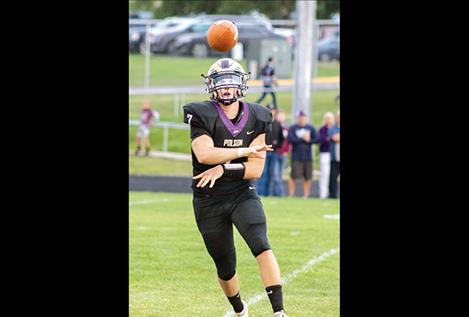Pirate senior quarterback Bo Kelley unloads the ball to a Polson receiver.