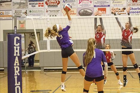 Lady Viking Kira McPhail battles at the net.