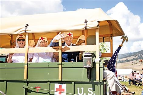 During the Dayton Daze parade on Saturday, one float carried several women dressed as D-Day nurses.