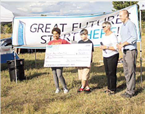 The Greater Polson Community Foundation presents a donation of $50,000 towards the new building fund.