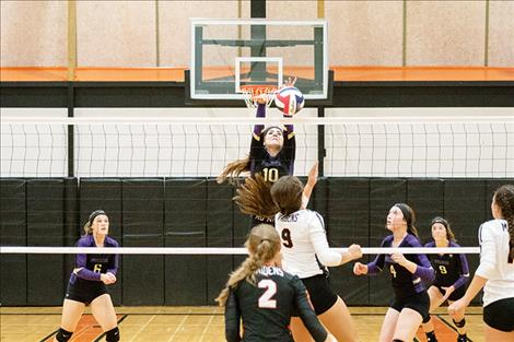 Lady Pirate Misty Tenas battles at the net on Friday during Ronan's homecoming game.
