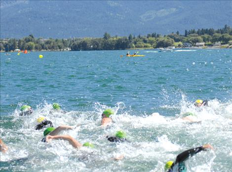 Water Daze swimmers churn up waves in Polson Bay Saturday afternoon. Nearly 80 people swam the mile-long course from the KwaTaqNuk Resort to Boettcher Park, with the fastest swim clocking in at 23 minutes, 27 seconds.