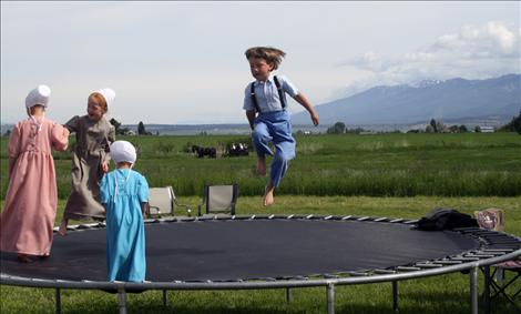 Children bounce happily on a trampoline during the first-annual Horse Progress Days.