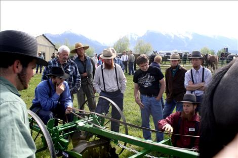 Pioneer Equipment Inc. demonstrators answer questions regarding many of their farm implements