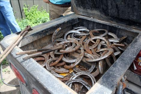 Used horse shoes rest in the bed of farrier Cam Lytle's truck.