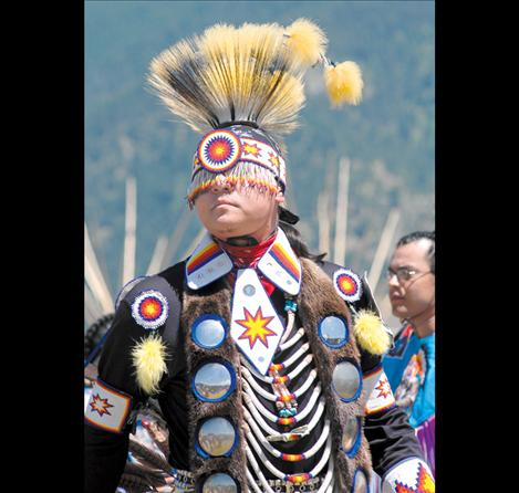 A dancer from a previous Arlee Celebration stands in full regalia.