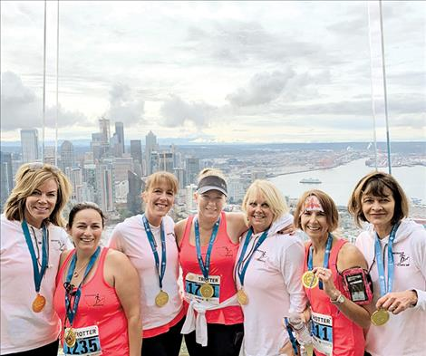 adies from the Mission Valley pose at the top of Seattle's Space Needle after climbing the 90-story iconic structure last month to benefit cancer research.
