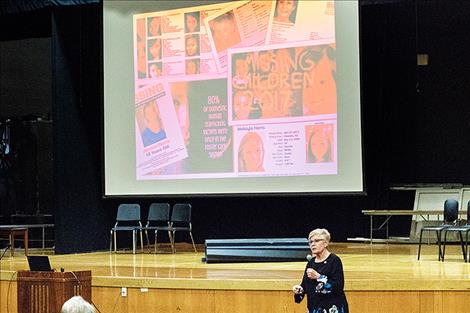 Approximately 100 people gathered for a free community seminar on human trafficking at the Polson High School auditorium.