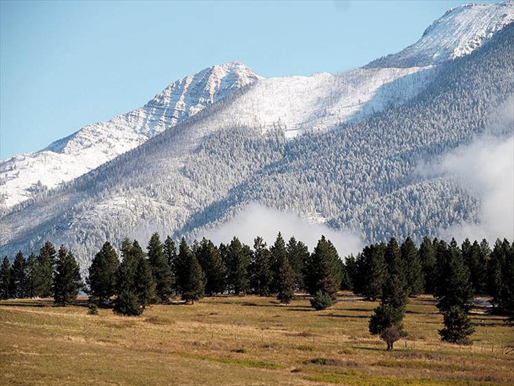 Snow-capped peaks: Mountains settle into winter mode in St. Ignatius.