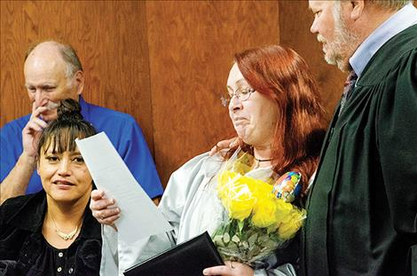 Diana Dalke receives a Lake County Drug Court completion certificate from Judge James Manley.