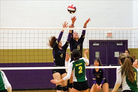 Lady Pirate Grace Quinones serves against Whitefish during senior night on Thursday evening.